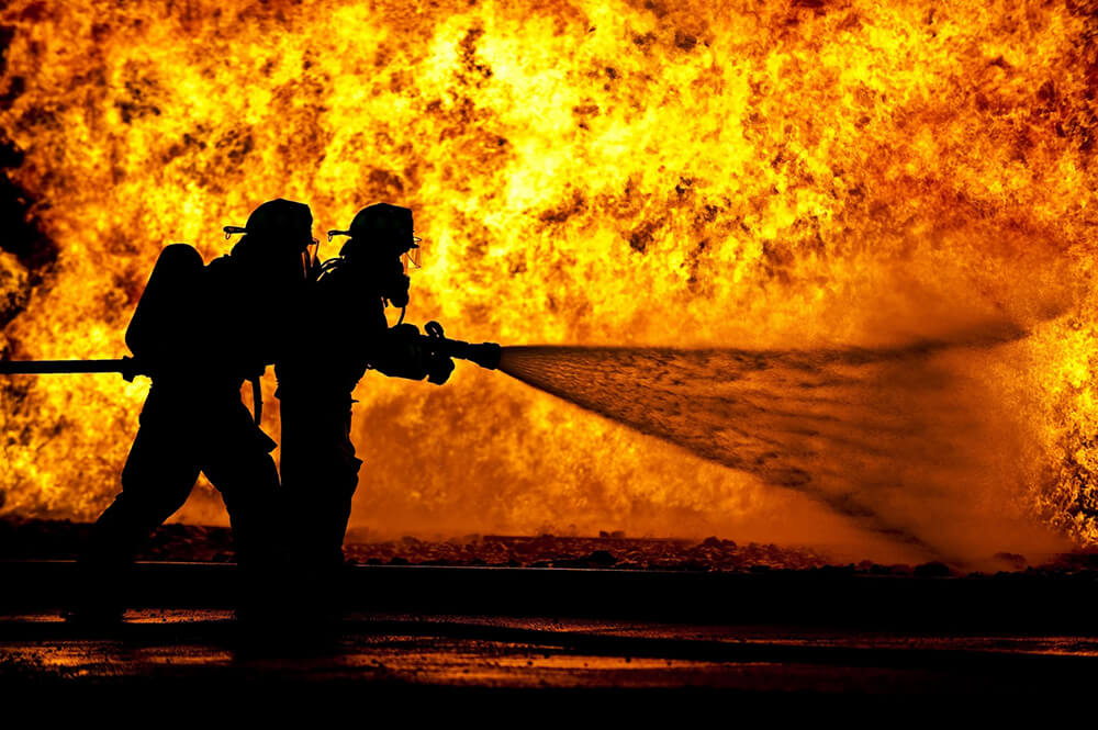 Fire fighters tackling fire